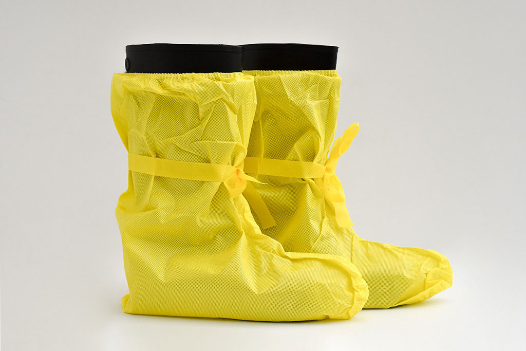 IMG Europe's protective clothing includes foot protection, such as disposable galoshes.